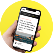 Phone with a Skift article on it