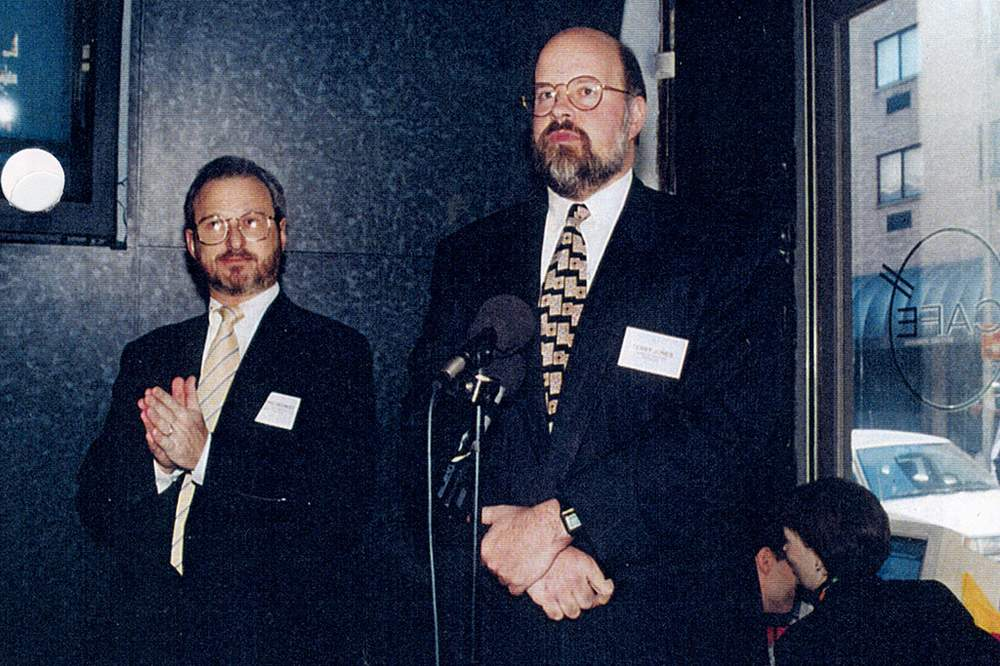 Terry Jones, right, speaking at the Travelocity launch party in New York City alongside Worldview president Neal Checkoway