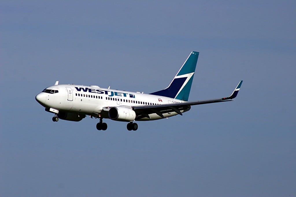 A WestJet flight arrives in Toronto. Although it's a low-cost carrier, WestJet has higher prices than its peers in other countries.