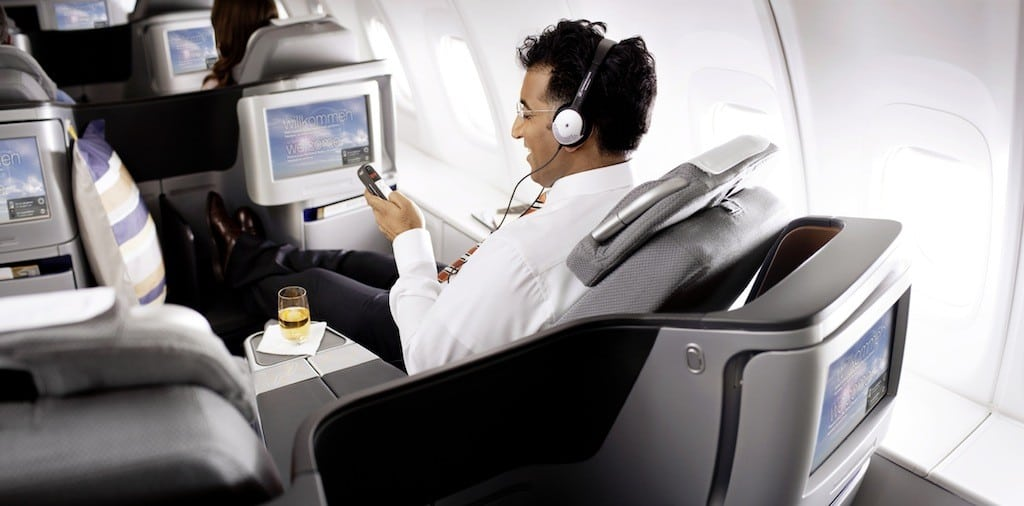 A passenger in the new Lufthansa business class, which is replacing first class on some planes.