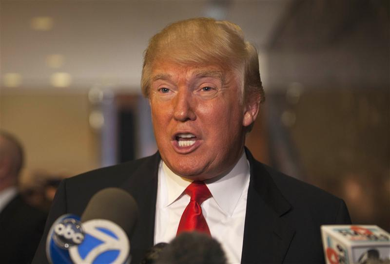 Donald Trump speaks to members of the media after a meeting with Republican presidential candidate Newt Gingrich at Trump Towers.