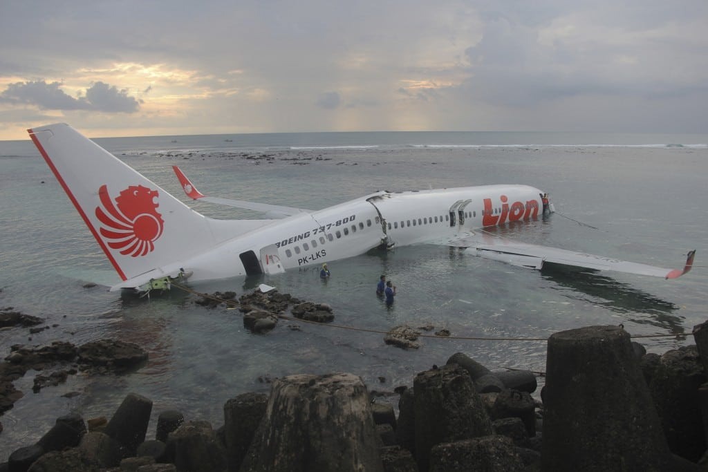 A handout picture provided by the Indonesian police, a Lion Air plane is seen in the water after missed the runway in Denpasar, Bali