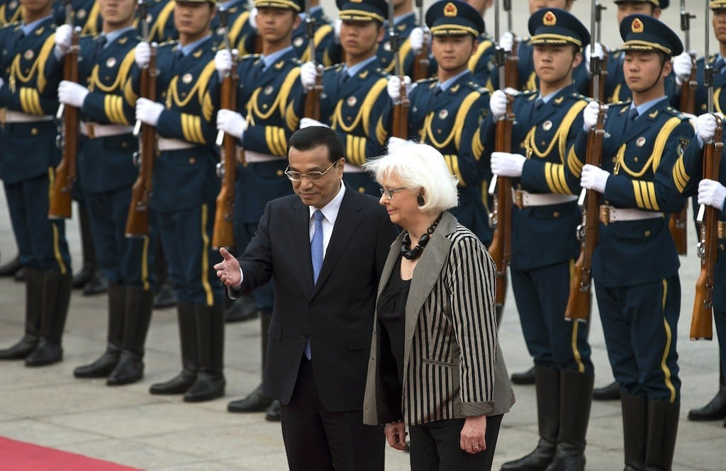Iceland's Prime Minister Johanna Sigurdardottir, right, is shown the way by Chinese Premier Li Keqiang after inspecting a guard of honor during a welcome ceremony outside the Great Hall of the People in Beijing Monday, April 15, 2013.