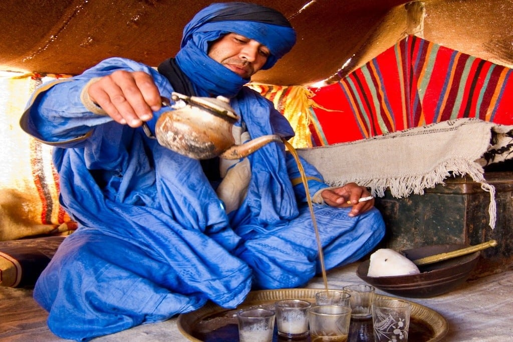 A Tuareg man pours tea for tourists in southern Morocco.