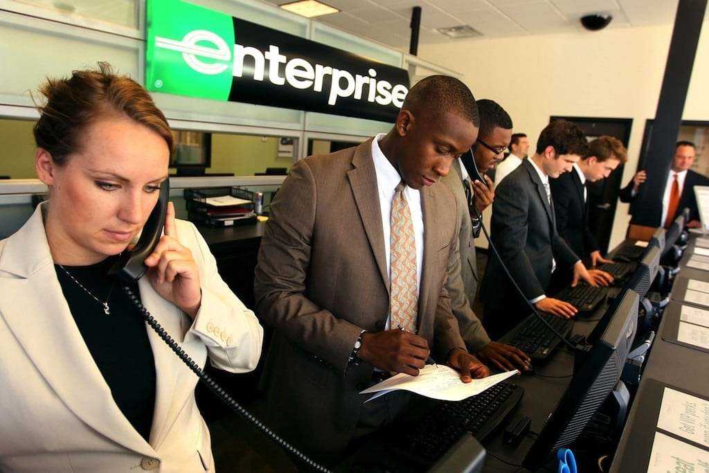 Jaclyn Waggoner, left, and Jason Gillespie, center, work the counter at a Enterprise Rent-A-Car office in St. Louis, Missouri, on August 30, 2012.