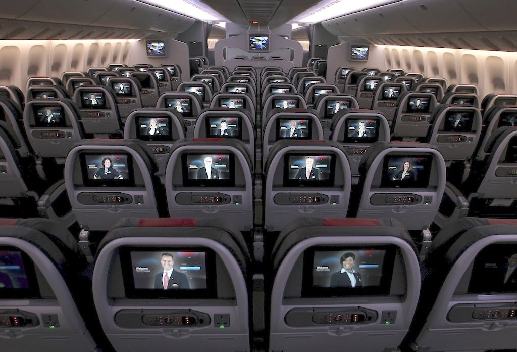 The monitors in coach are featured on the new American Airlines Boeing 777-300ER at Terminal D at DFW Airport in Euless, Texas, January 31, 2013. The Justice Department says U.S. airlines vigorously monitor each others' fares and sometimes coordinate them.