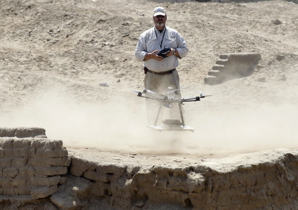 Luis Jaime Castillo, a Peruvian archaeologist with Lima's Catholic University and an incoming deputy culture minister, flies a drone over the archaeological site of Cerro Chepen in Trujillo August 3, 2013. Reuters / Mariana Bazo