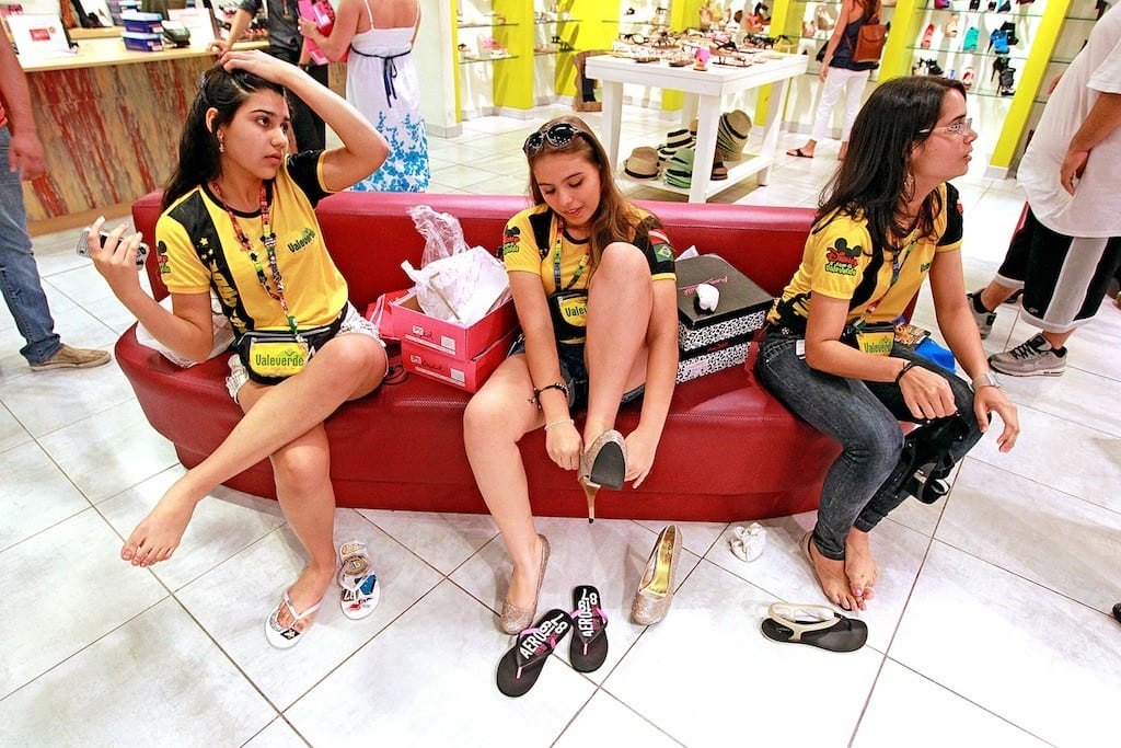 Karlona Goycalves 15, from left, Maria Luiza Cavacante 14, and Camila DeSouza 17, of Brazil, shops for shoes at Sawgrass Mills mall in Sunrise, Florida.