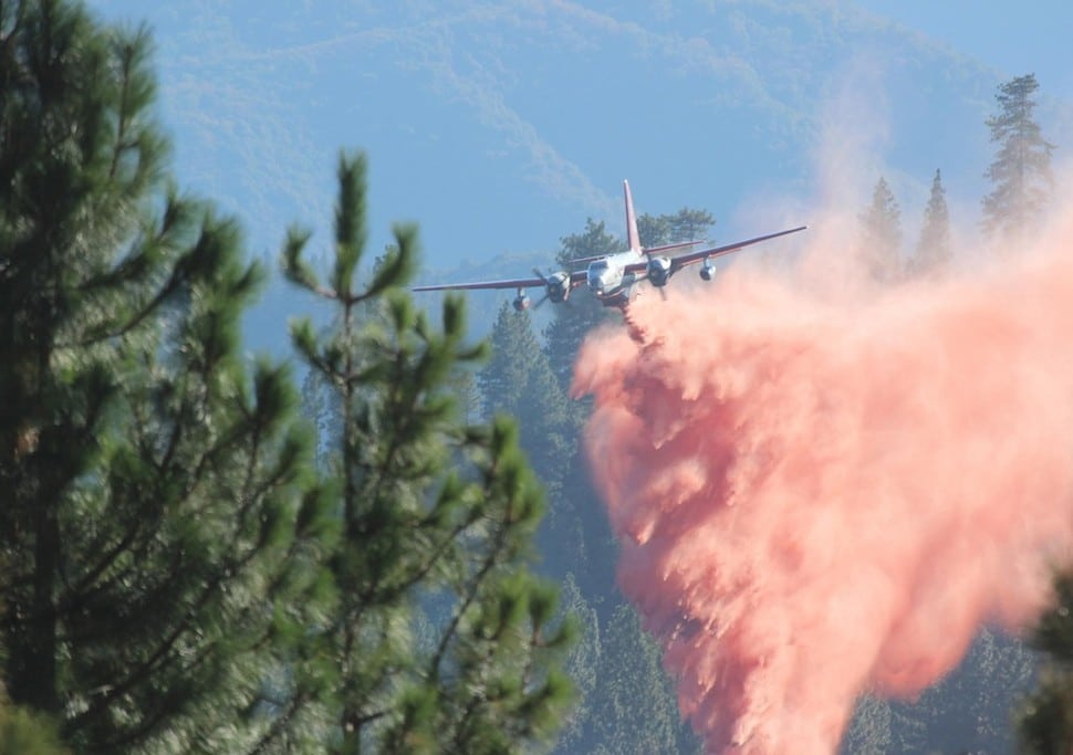A tanker drops retardant on the Rim Fire in this undated United States Forest Service handout photo near Yosemite National Park, California, released to Reuters August 30, 2013. REUTERS/Mike McMillan/U.S. Forest Service/Handout