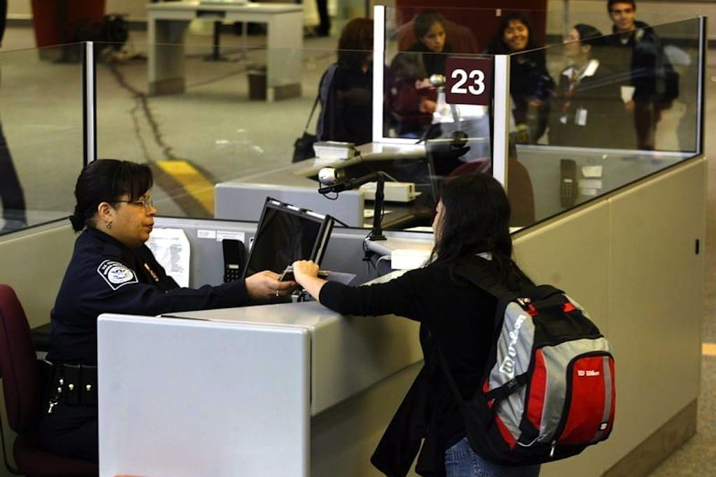 A foreign airline passenger is greeted by a Customs and Border Protection Officer at Hartsfield-Jackson International Airport in Atlanta, Georgia January 5, 2004.