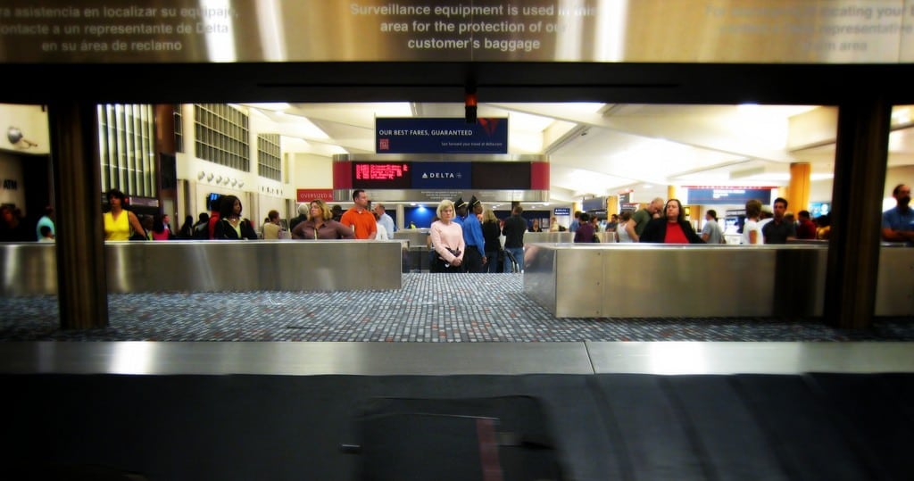 Most Spirit customers try to avoid checking and waiting for bags like these passengers at Atlanta-Hartsfield International Airport.