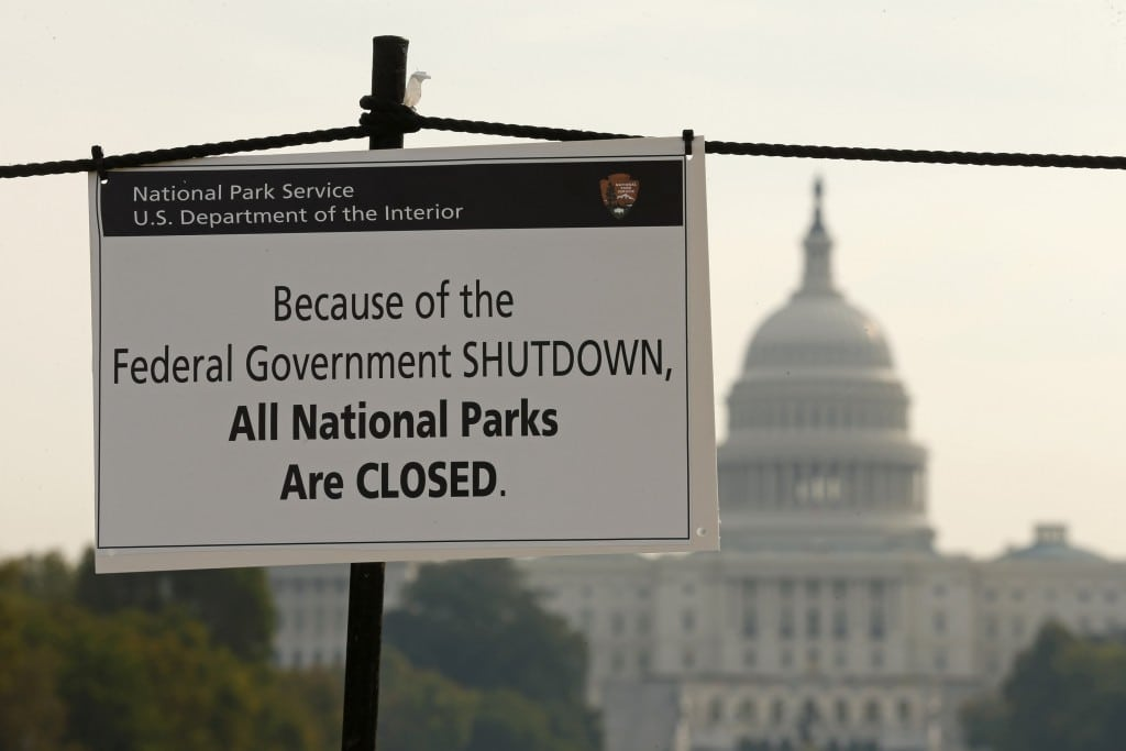 The U.S. Capitol looms in the background of a sign on the National Mall reminding visitors of the closures to all national parks due to the federal government shutdown in Washington.