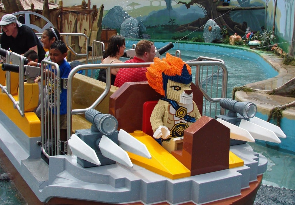 Guests aim water cannons as they participate in a ride at the World of Chima attraction at Legoland in Orlando, Florida.