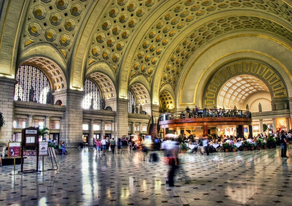 Union Station, Washington, D.C.: The 96-foot high coffered Main Hall ceiling shines with gold leaf, reflecting light onto the expanse of its marble floor through spacious skylights and windows. The former Main Concourse, now the heart of the station, lifts its barrel-vaulted glass and coffered plaster ceiling 45 feet above the main floor and stretches 760 feet long. It was once said to be the largest single room in the world.