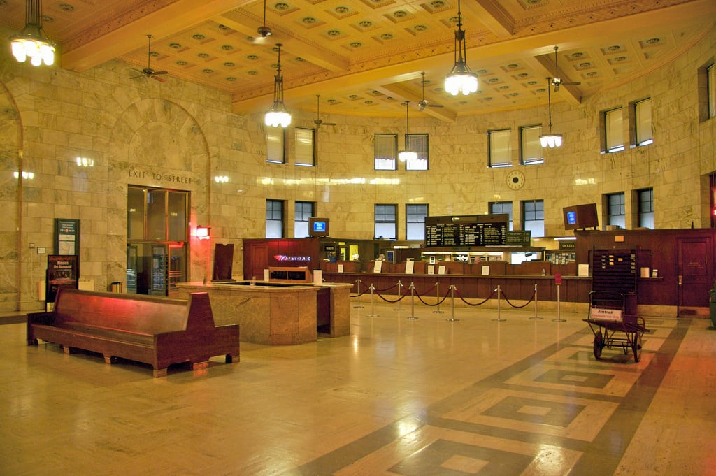 Union Station, Portland OR: Between 1927 and 1930, the station's interior received a major redesign. The main waiting hall was completely opened up by eliminating the cast iron columns and an entire mezzanine level. Italian marble was added to the walls and the floor. Dormers were added to the exterior to permit more natural light to enter the station.