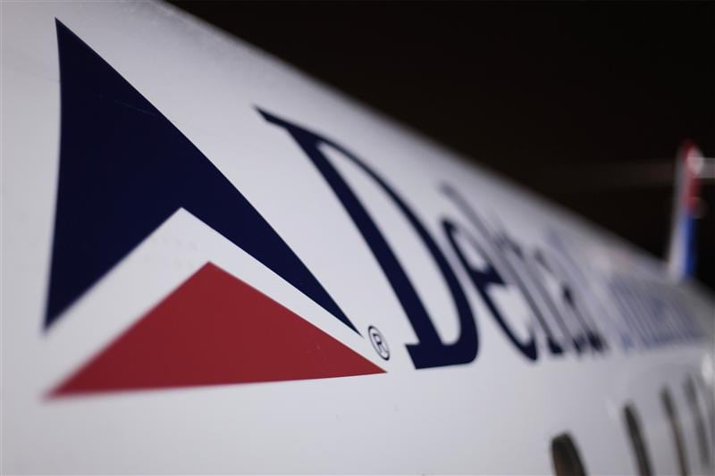 A Delta plane sits on a runway prior to takeoff at John F Kennedy International Airport in New York December 25, 2009.