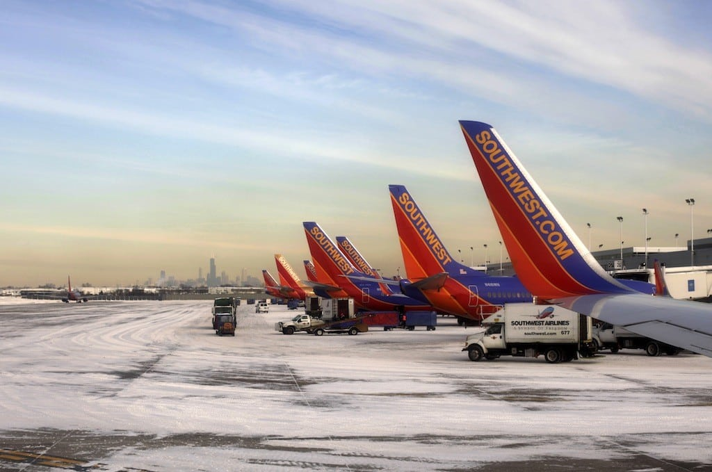 In this Wednesday, Jan. 8, 2014, photo, Southwest planes line up in Chicago. Southwest reports quarterly earnings on Thursday, Jan. 23, 2014.