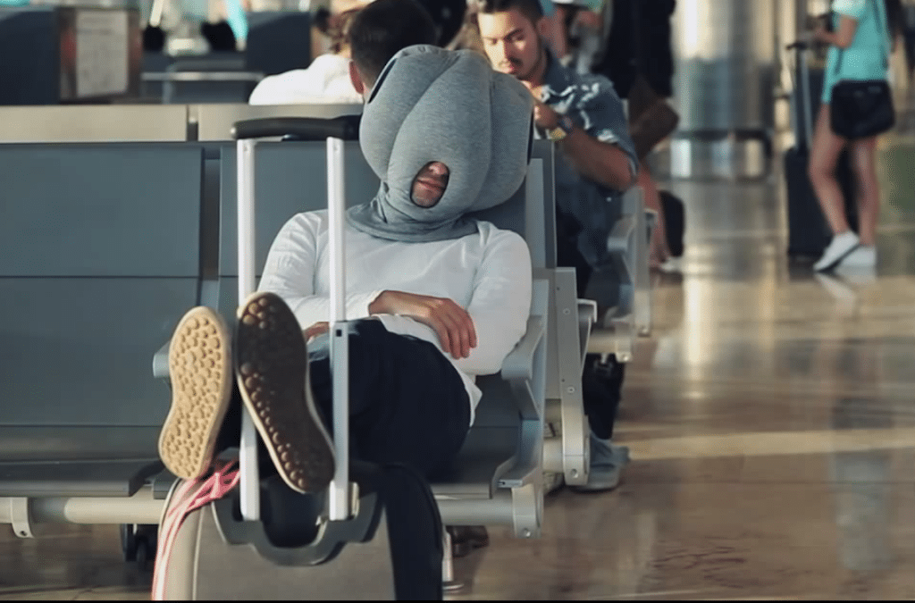 The Ostrich Pillow may be a nice option for some if you don't mind looking like a Teletubby when you travel.
