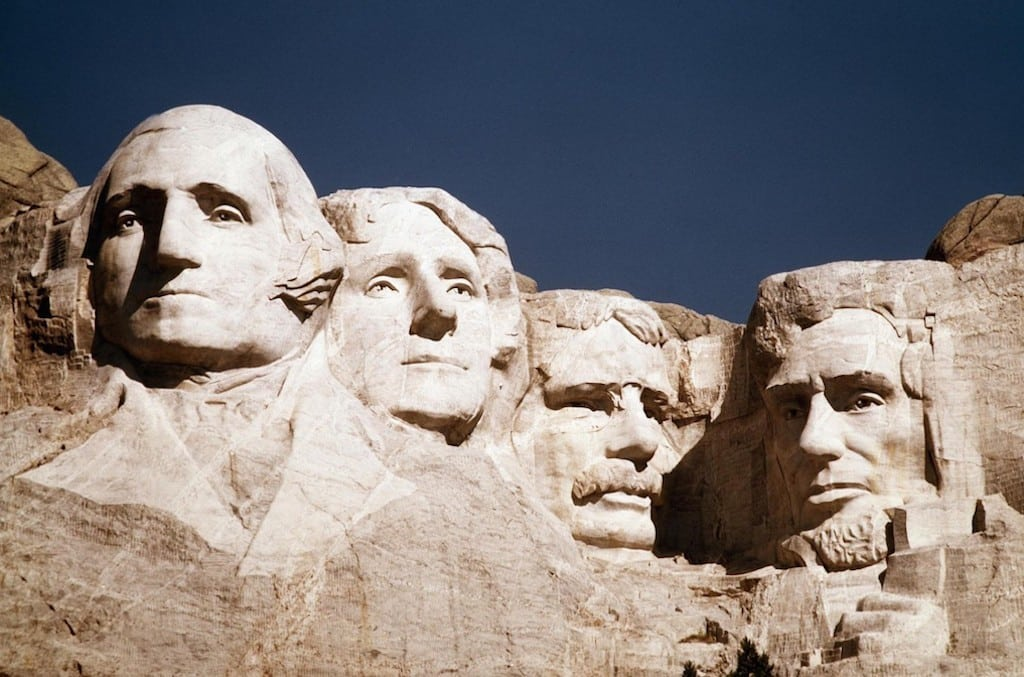 File - This undated file photo shows the statues of George Washington, Thomas Jefferson, Teddy Roosevelt and Abraham Lincoln at Mount Rushmore in South Dakota.