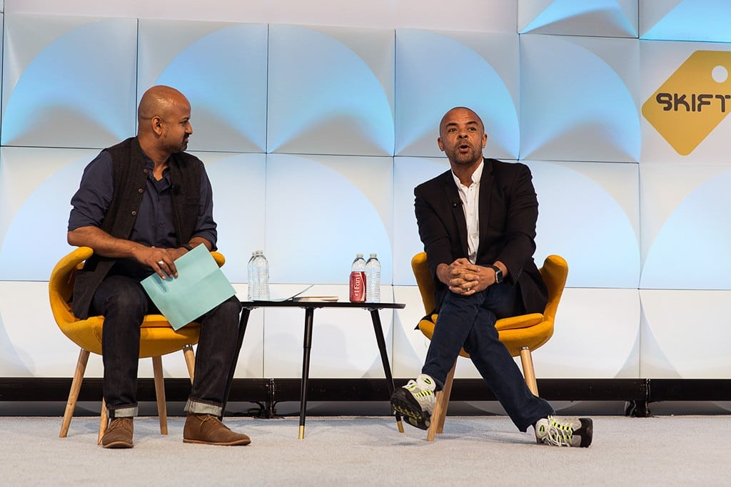 Airbnb CMO Jonathan Mildenhall (right) speaking with Skift CEO Rafat Ali at Skift Global Forum in New York in 2015.