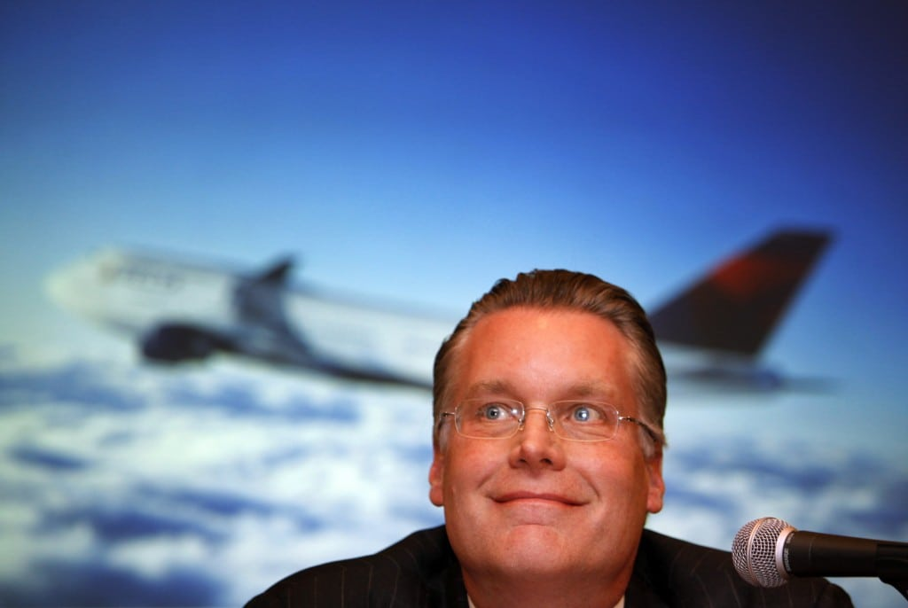 Delta Air Lines President Edward Bastian smiles as he listens to questions from the media during a news conference in Tokyo.
