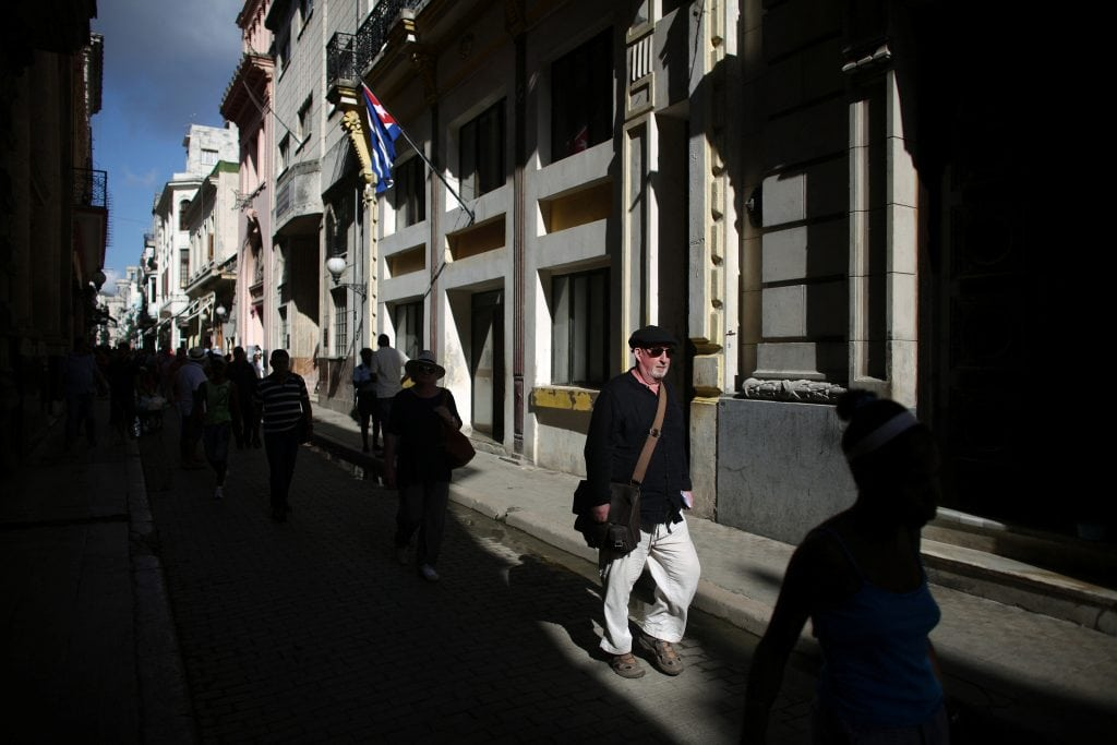 A tourist walks on the main touristic road in Old Havana, Cuba, May 4, 2016.