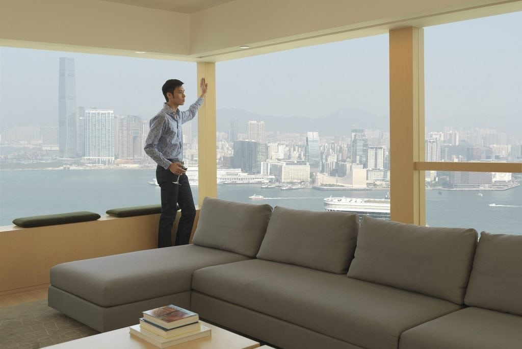 A man in a room at the Upper House in Hong Kong, which uses a light touch rather than big data.
