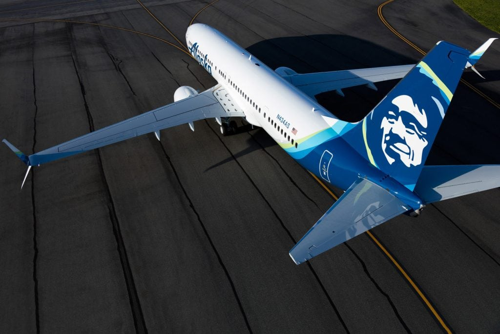 An Alaska Airlines plane on the tarmac. The carrier is creating special bonuses for passengers flying partner airlines.