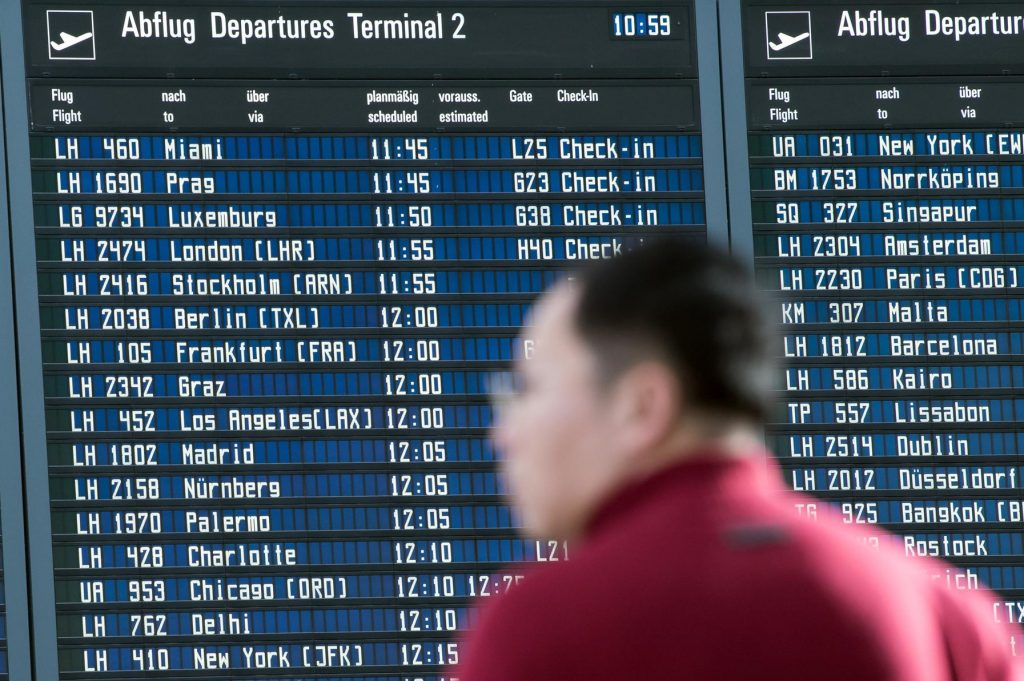 A passenger standing in front of the display board  for departures at the airport in Munich, Germany, Tuesday Nov. 29, 2016. Privacy International said Android apps such as Kayak's have been sharing users' detailed travel information with Facebook in ways that border on making the user personally identifiable.