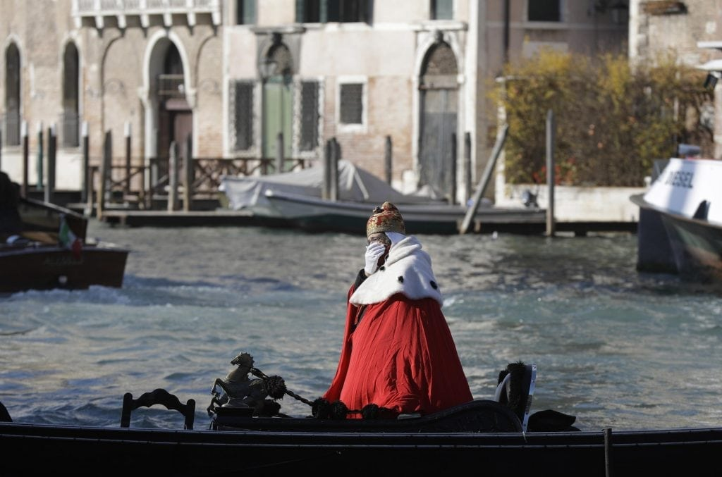 A protester on a gondola impersonates the