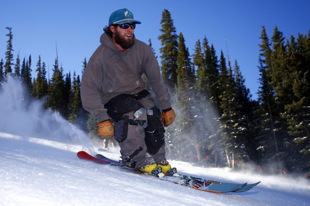 A skier enjoys a run on the opening day of ski season at Arapahoe Basin Ski Area in Colorado. Smaller resorts can't compete with the big guys, so they tout authenticity.
