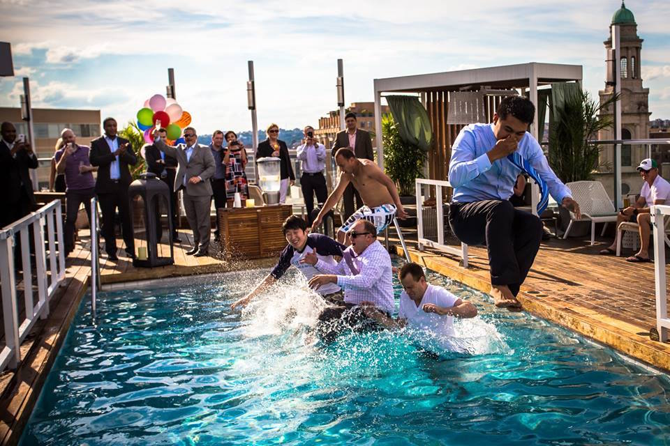 Numerous travel startups help hotels engage with their guests. Pictured, guests and staff seems excited about the opening of the swimming pool at The Donovan, a Kimpton Hotel, in Washington, D.C. in May 2015.