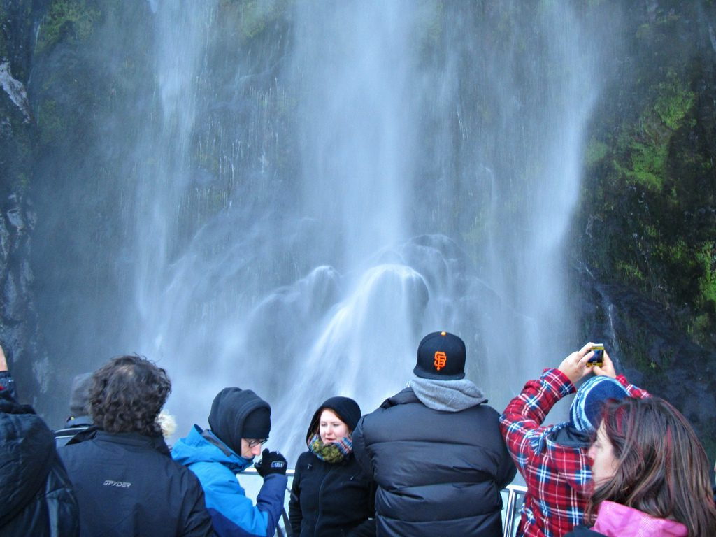 Infrastructure in many parts of New Zealand can't handle increased tourism. Pictured are tourists at Stirling Falls on New Zealand's South Island.