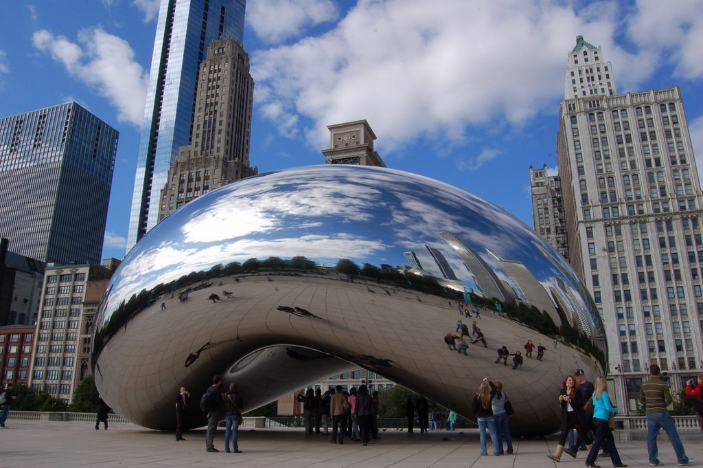 Online international bookings on flights to the U.S. have largely decreased in early 2017. Tourists in Chicago's Millenium Park mill around in this photo.