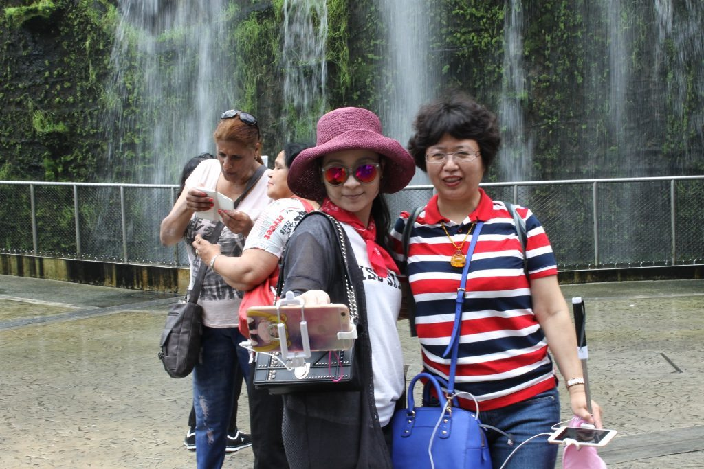 Chinese tourists, like those pictured here in Singapore, spent $261 billion on foreign trips in 2016.
