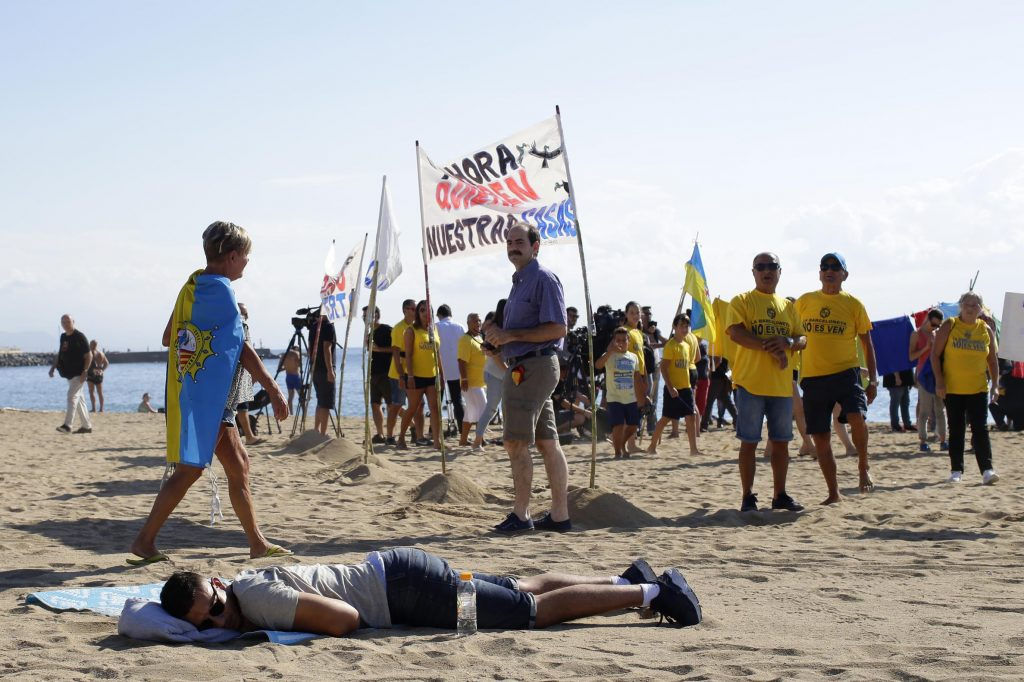 The backlash against tourists in Spain has been building. In Barcelona this weekend, a visitor slept on the beach next to an anti-tourism gathering.
