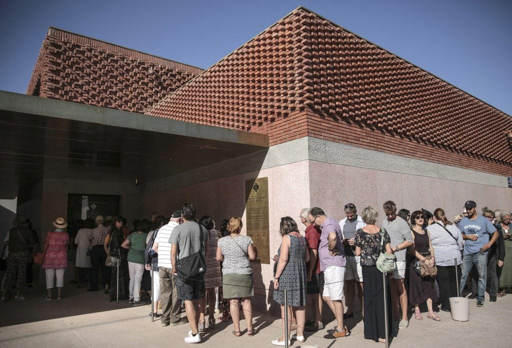 Visitors queue to visit the Yves Saint Laurent museum as it opens its doors to the public in Marrakech, Morocco, on Thursday.