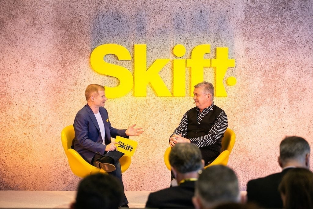 Travelport CEO Gordon Wilson, right, opines on the future of corporate travel at Skift Tech Forum on Tuesday.