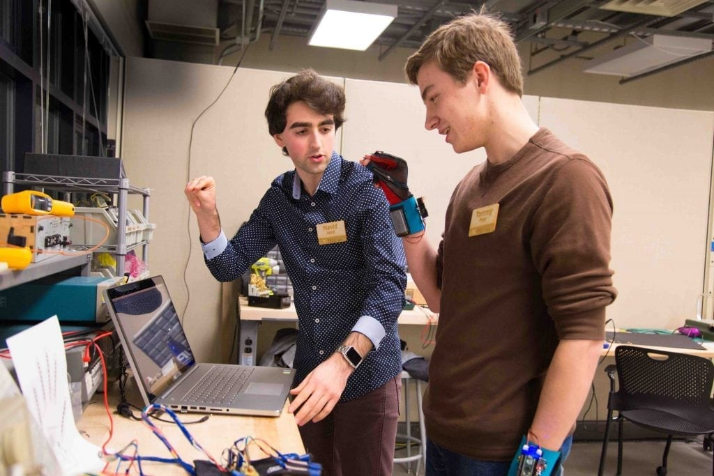 Two students at the University of Washington, Navid Azodi (left) and Thomas Pryor (right), demonstrate their invention of a glove that transliterates sign language into speech. Tools like that can help people with disabilities travel better. There's been a wave of efforts in the past year-and-a-half to help people with mobility, hearing, and sight challenges travel more easily.