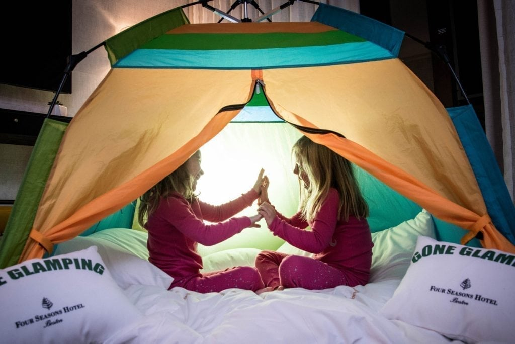 Children play in a tent at the Four Seasons Hotel Boston.