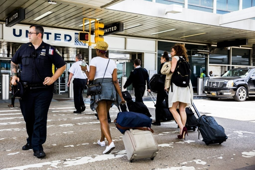 Travelers at New York's LaGuardia Airport the day President Trump's travel ban will go into effect on June 29th, 2017.