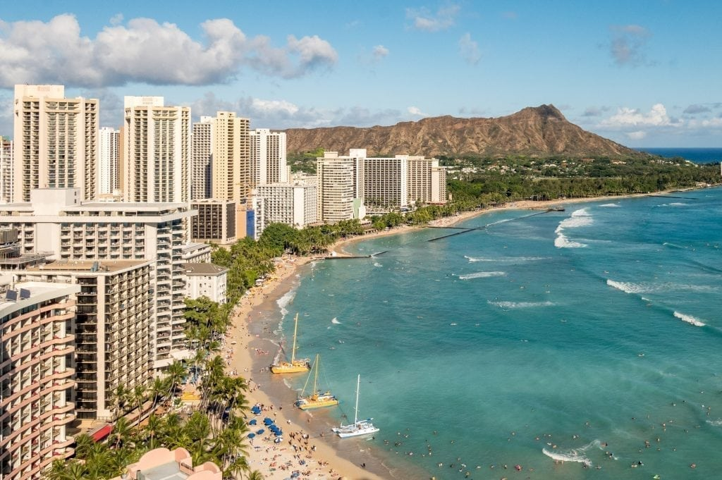Online travel agencies make many hotels and tours and activities, such as those in Honolulu, shown here, available to book online.