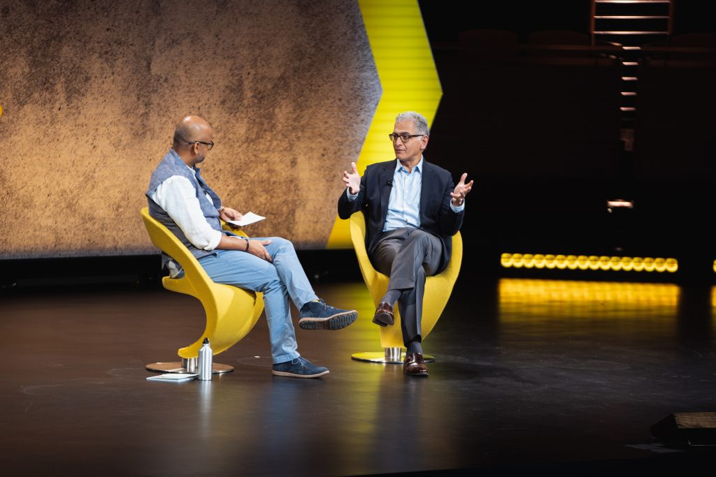 Hyatt Hotels CEO Mark Hoplamazian (right) and Skift founder and CEO Rafat Ali speaking on stage at Skift Global Forum in New York City on September 27, 2018.