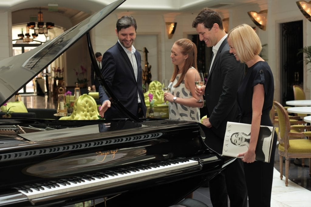 Kornél Magyar (left) sharing some of his musical insights with guests at the Aria Hotel in Budapest.