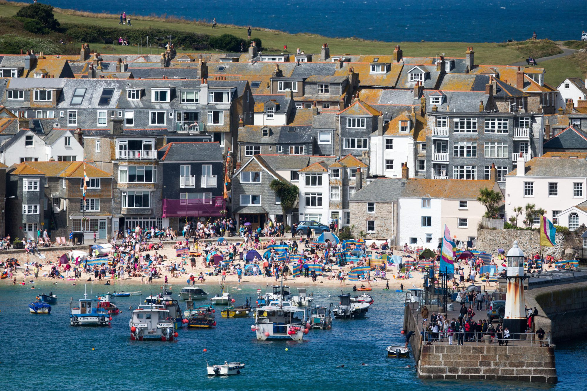 Cornwall, the southwest peninsula of Britain, is struggling to find enough bartenders to serve the millions who flock to the rocky coastline every year.  / Bloomberg
