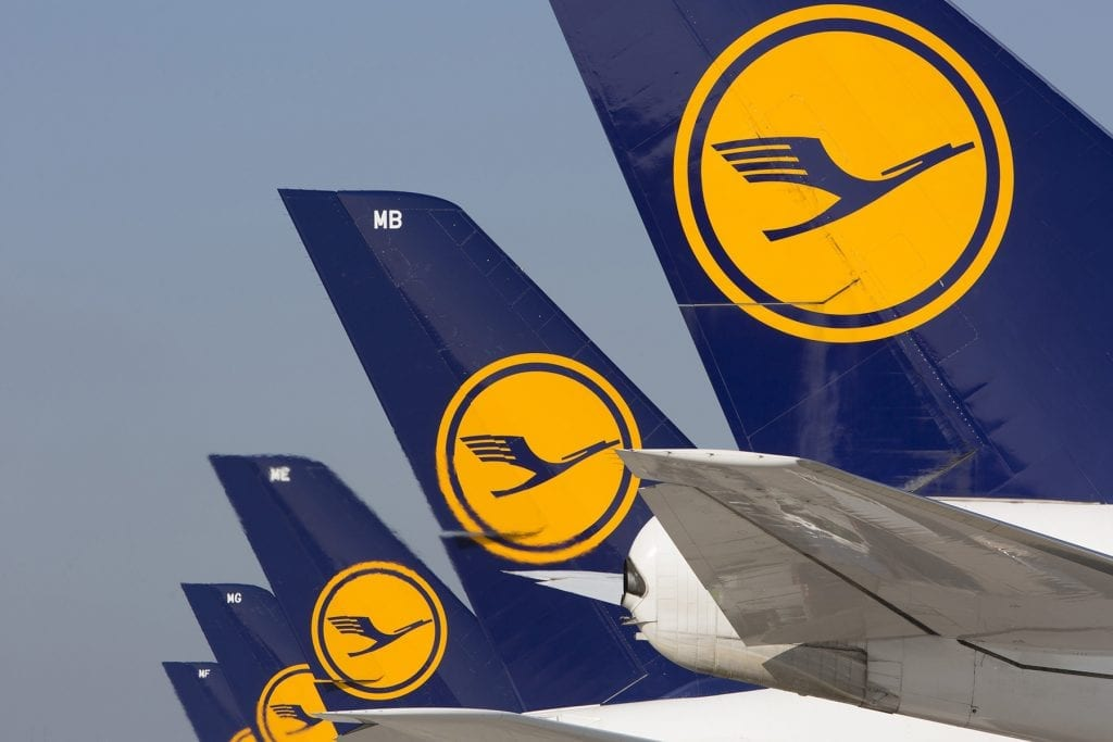 Lufthansa aircraft lined up at an airport. Some airlines will be jealous of Lufthansa Group's ability to have one out of every two of its customers in December book directly rather than through more costly middlemen.