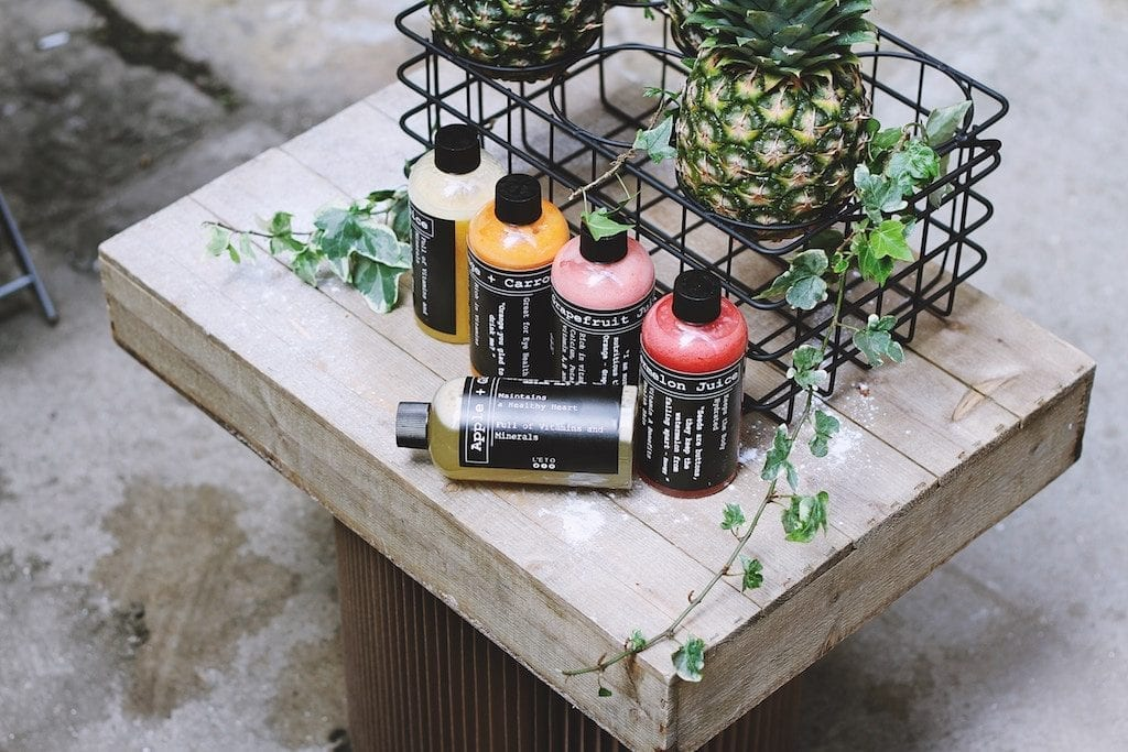 An array of juices are shown. Brands are getting creative to get it on the growing consumer wellness trend.