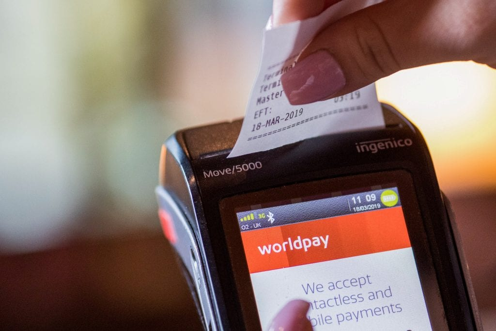 An image of a point-of-sale device powered by Worldpay, a payments technology company that has been bought by Fidelity National Information Services (FIS) will buy Worldpay in a $34 billion deal that will be one of the largest transactions yet in the fast-consolidating payments sector.