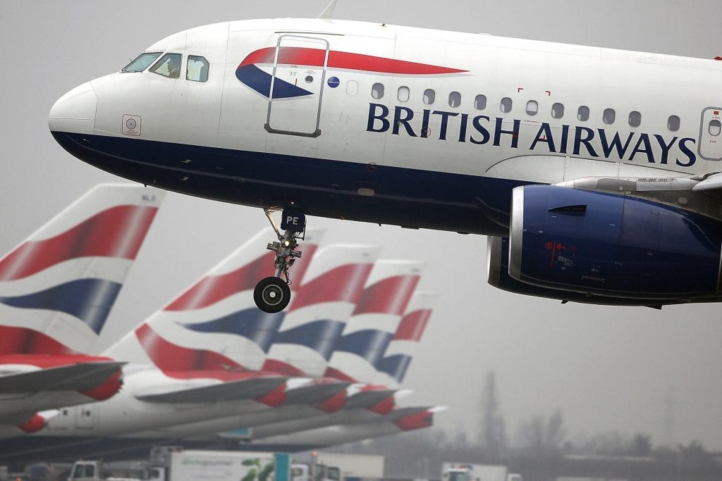A British Airways airplane comes into land at Terminal 5 at Heathrow airport in London. The carrier faced an IT glitch at London in early August, extending a string of tech troubles.