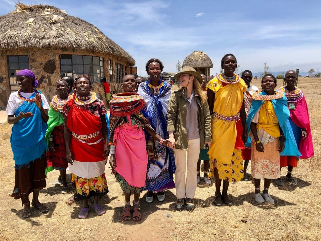 Indagare Travel founder and CEO Melissa Biggs Bradley with members of the Maasai tribe in Kenya in 2018. Indagare hires in-house specialists who design highly customized travel experiences.